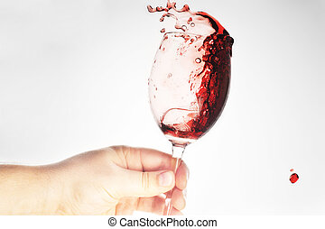 hand holding glass with wine