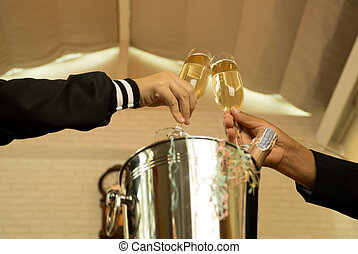 Hand  holding glasses of champagne making a toast