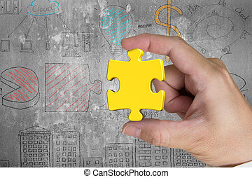 Hand holding gold jigsaw puzzle piece with business concept dood