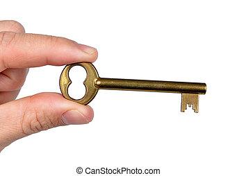 Hand holding golden door key