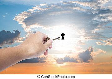 Hand holding golden key