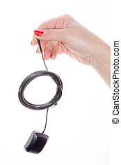 Hand holding GPS cable on a white background