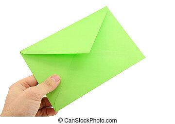 hand holding green envelope