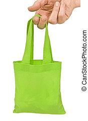 Hand Holding Green Shopping Bag