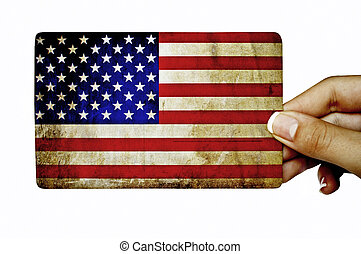 Hand holding grunge card with American flag