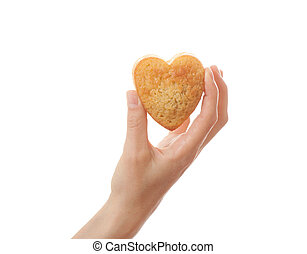 Hand holding heartshape cake