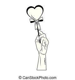 Hand holding heartshape lollipop pop art in black and white