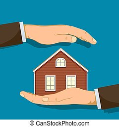 Hand holding house. Real estate or safety concept.