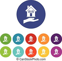 Hand holding house set icons