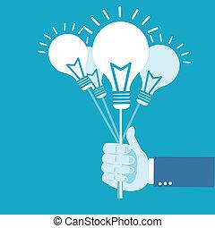Hand holding idea balloon