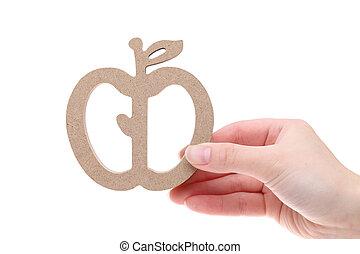 Hand holding imitation apple