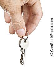 Hand holding keys isolated on white
