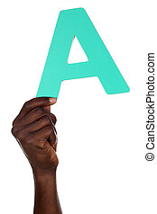 Hand holding letter A from alphabet