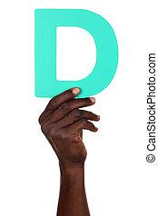 Hand holding letter D from alphabet