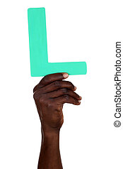Hand holding letter L from alphabet