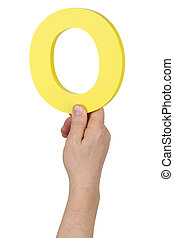 Hand holding letter O number 0 from alphabet