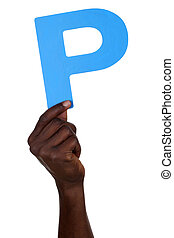 Hand holding letter P from alphabet