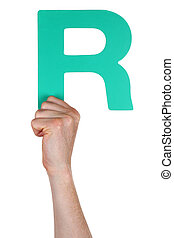 Hand holding letter R from alphabet