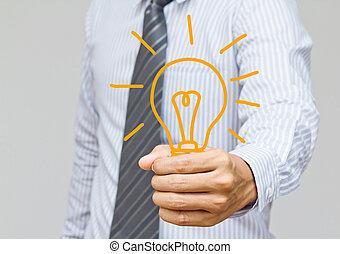 hand holding light bulb