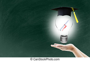 hand holding light bulb with certification for graduation shows the ingenuity intelligence knowledge and success for education on blackboard
