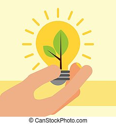 hand holding light bulb with plant ecology