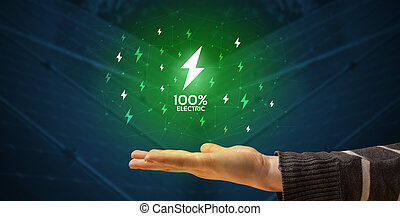 Hand holding lightning bolt
