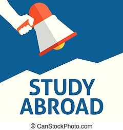 Hand Holding Megaphone With STUDY ABROAD Announcement. Flat...