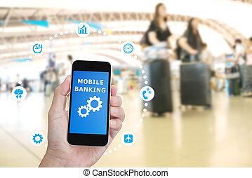 Hand holding mobile phone with Mobile banking application with blur crowd people background