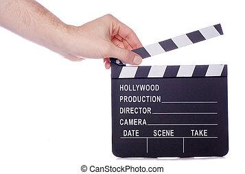 Hand holding movie clapper board cutout