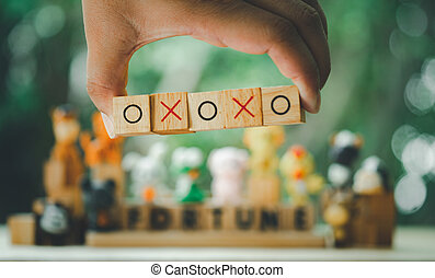 Hand holding O and X symbol print screen on wooden cube mean of correct or incorrect mindset concept.