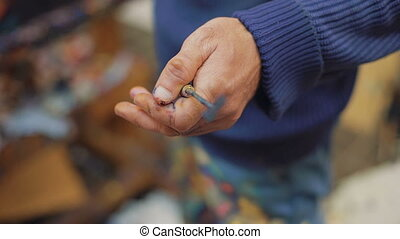 Hand holding palette knife - Hand holding palette knife....