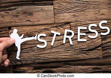 Hand Holding Paper Businessman Kicking Word Stress - Closeup...