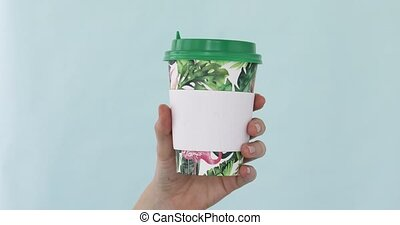 Hand holding Paper cup of hot drink