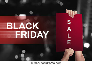 Hand holding paper with sale text on Black Friday