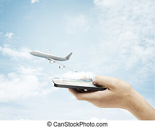 airliner in sky - hand holding phone and airliner in sky