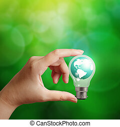 hand holding, planet erde, in, a, lightbulb, als, energie, begriff