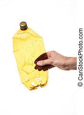 Hand holding plastic bottle