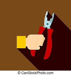Hand holding pliers with red handles icon