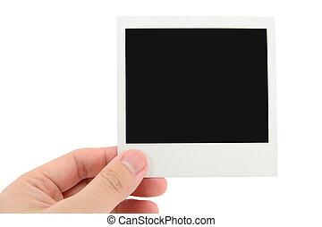 polaroid photo - hand holding polaroid photo with white...