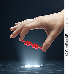hand holding puzzle - hand holding red puzzle isolated on...