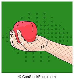 Hand holding red apple on green background