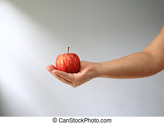 hand holding red apple.