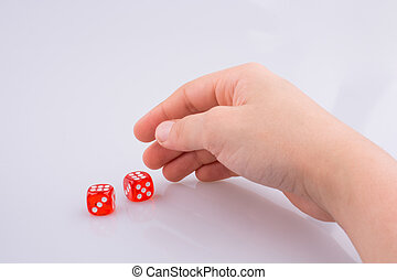 Hand holding red dice