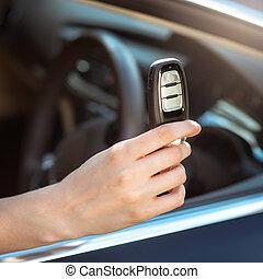 hand holding remote car key