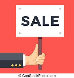 Hand holding sale placard