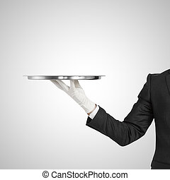 hand holding silver plate on a white background