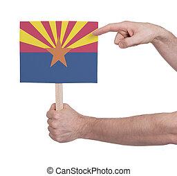 Hand holding small card - Flag of Arizona