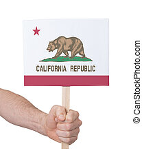 Hand holding small card - Flag of California