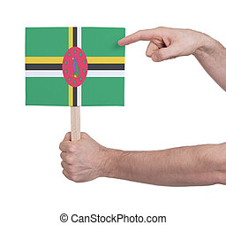 Hand holding small card - Flag of Dominica