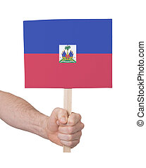 Hand holding small card - Flag of Haiti